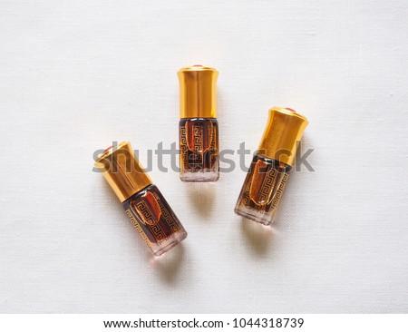 Arabian oud attar perfume or agarwood oil fragrances in mini bottles. #1044318739