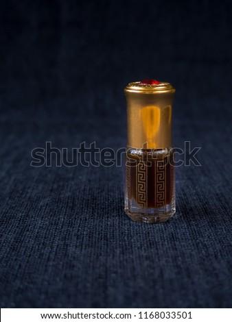 Arabian oud attar perfume or agarwood oil fragrances in mini bottles. #1168033501
