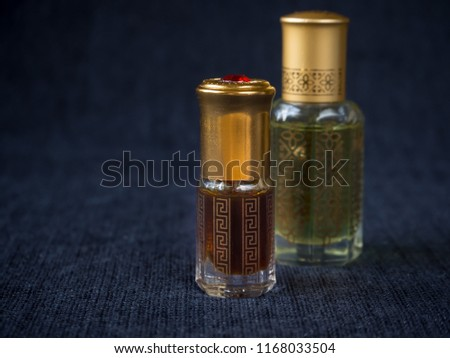 Arabian oud attar perfume or agarwood oil fragrances in mini bottles. #1168033504