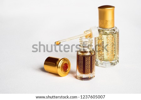 Arabian oud attar perfume or agarwood oil fragrances in mini bottles. #1237605007