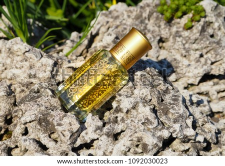 Arabian oud attar perfume or agarwood oil fragrances in mini bottles on a natural background. #1092030023
