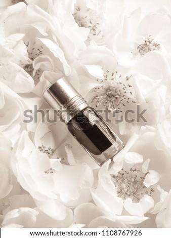 Arabian oudh attar perfume or agarwood oil fragrances with rose in mini bottle.  #1108767926
