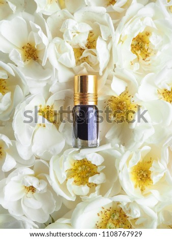 Arabian oudh attar perfume or agarwood oil fragrances with rose in mini bottle.  #1108767929