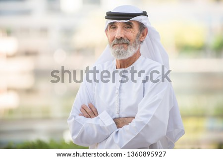Arabian senior man with traditional white kandura portrait