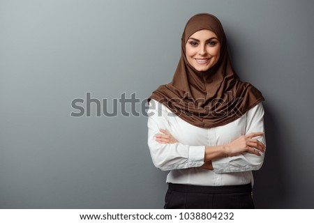 Arabian woman with happy smile. Strict formal outfit and elegant appearance. Islamic fashion.