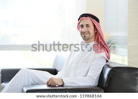 Arabic adult sitting in office