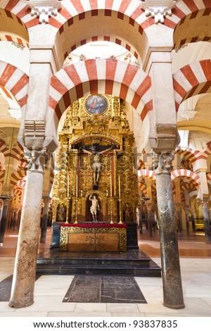 Arabic arches framing a christian altar in Corodoba's mosque. Spain