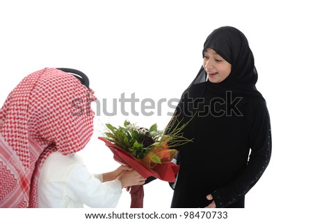 Arabic boy with keffiyeh and flowers present for sister