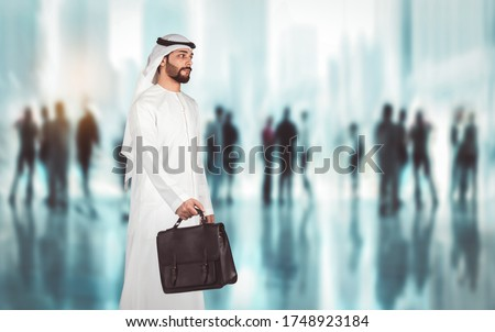 Arabic businessman walking in the office center going to visit meeting conference of business corporation to report about advantages of new creative advertising campaign.