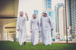 Arabic businessmen walking and talking in Dubai