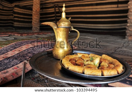 Arabic coffee jug and cookies served in Bedouin tent in the middle east.
