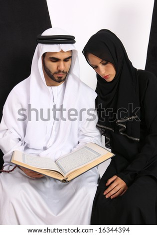 Arabic Couple Referring To The Holy Quran