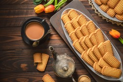 Arabic Cuisine; Cookies for celebration of El Fitr Islamic Feast (The Feast that comes after Ramadan). Delicious traditional biscuits served with cup of tea and milk. Top view with copy space.