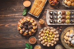 Arabic Cuisine; Cookies for celebration of El-Fitr Islamic Feast.(The Feast that comes after Ramadan). Varieties of Eid Al-Fitr sweets(kahk,biscuits, petit four). Top view with copy space.