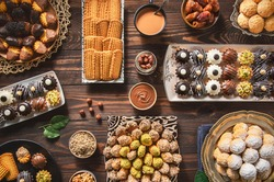 Arabic Cuisine; Cookies for celebration of El-Fitr Islamic Feast.(The Feast that comes after Ramadan). Varieties of Eid Al-Fitr sweets(kahk,biscuits, petit four). Top view with close up.