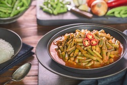 Arabic Cuisine; Egyptian traditional green bean stew. A delicious vegan meal with fresh green beans doused in aromatic tomato sauce. Served with white rice.