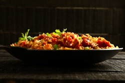 Arabic cuisine-Meat and rice stir fry with spices,cooked in wok,