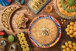 Arabic Cuisine: Middle Eastern desserts. Delicious collection of Ramadan traditional desserts. Served with tasty nuts, honey syrup and sugar syrup .Top view with close up.