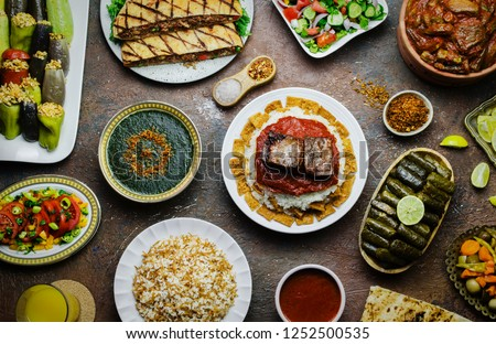 Arabic cuisine; Middle Eastern traditional lunch. It's also Ramadan 'Iftar'. The meal eaten by Muslims after sunset during Ramadan. Assorted of Egyptian oriental dishes. Top view with close up.