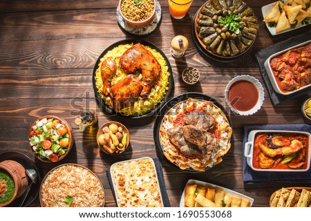 Arabic Cuisine: Middle Eastern traditional lunch. It;s also Ramadan 'Iftar' . The Meal eaten by Muslims after sunset during Ramadan. Assorted of Egyptian oriental dishes. Top view with copy space. ストックフォト ©