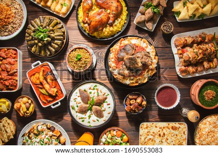Arabic Cuisine: Middle Eastern traditional lunch. It's also Ramadan 'Iftar'. The meal eaten by Muslims after sunset during Ramadan. Assorted of Arabic oriental dishes. top view with close up.  ストックフォト ©