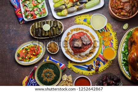 Arabic cuisine;Middle Eastern traditional lunch.It's also Ramadan 'Iftar'.The meal eaten by Muslims after sunset during Ramadan.Assorted of Egyptian dishes placed on ethnic Egyptian cloths for Ramadan