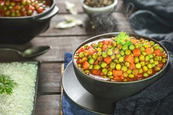 Arabic Cuisine; Middle Eastern traditional peas and carrot stew. A delicious vegan meal with peas and carrot doused in aromatic tomato sauce. Served with white rice and oriental pickles.