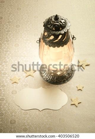 Arabic decorative lantern and empty tag. Eid or Ramadan festival background.