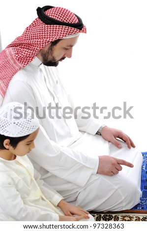 Arabic father and son praying together