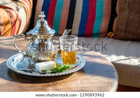 Arabic fresh Mint Tea is drunk all over Morocco and the Arab world and is a must try for all tourists visiting the region. Set in a classic moroccan interior decor with textile furnishings. Copy Space