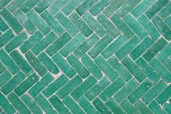 Arabic green herringbone tile pattern background