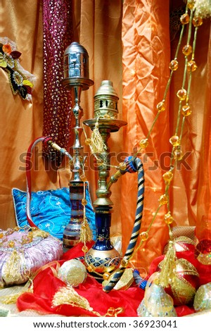 Arabic hookah over colorful pillows and decorations