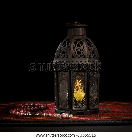 Arabic lantern with wooden rosary