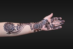 Arabic Mehndi Design Woman's Full Hand and Fingers Front Side with Isolated Black Background,  in the Muslim and Hindu Marriage (Wedding)  Ceremony Also Known as (Rasam-e-Henna).