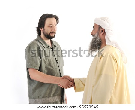 Arabic Muslim businessman person shaking hands on meeting - stock photo