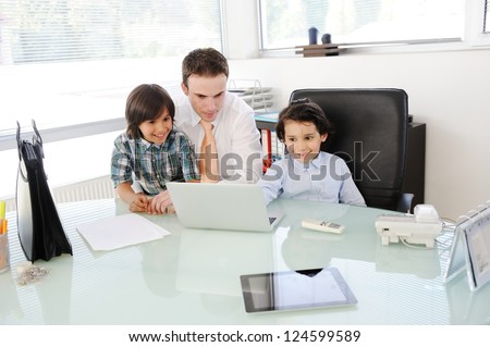 Arabic Muslim father teaching his sons in office