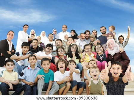 Arabic Muslim portrait of very big family group with many members, 3 generations #89300638
