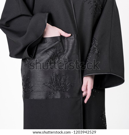 arabic muslim woman in stylish abaya, in white background