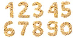 Arabic numerals   from muesli with coconut, berries, raisins, cereal and natural cereals  on a white isolated background. Food pattern made from granola.  bright  numeral for design.