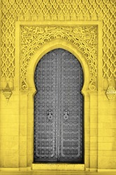 Arabic oriental styled door in Morocco. Illuminating and Ultimate gray Pantone color of the year 2021