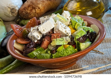 Arabic salad topped with cheese.