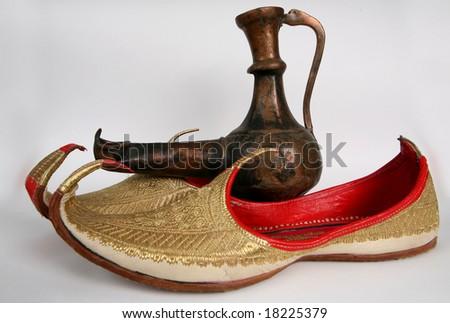 Arabic slippers and Aladdin Lamp.
