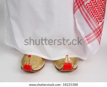 Arabic slippers and Aladdin on white background.