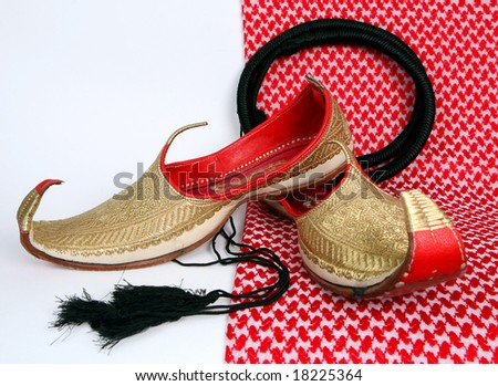 Arabic slippers on white background.