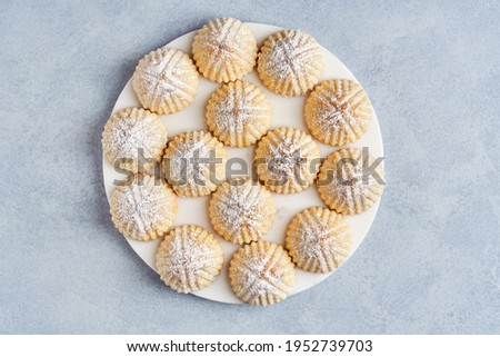 Arabic sweets. Traditional eid semolina maamoul or mamoul cookies with dates , walnuts and pistachio nuts .  Top view