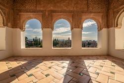 Arabic windows in the Patio de la Acequia, part of the Generalife complex. Panoramic view of Alhambra in Granada, Spain.