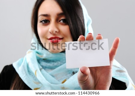 Arabic woman holding visit card with copy space