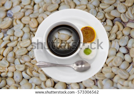 arabica coffee beans on shell beans background