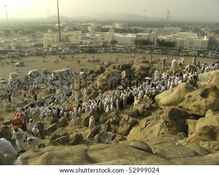 ARAFAT - DEC 29 : Muslims at Mount Arafat (or Jabal Rahmah) Dec 29, 2007 in Arafat, Saudi Arabia. Muslims believe it is here where prophet Adam and Eve met after they were thrown out from heaven.