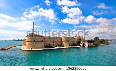 Aragonese Castle of Taranto and revolving bridge on the channel between Big and Small sea, Puglia, Italy, Blue sunny sky